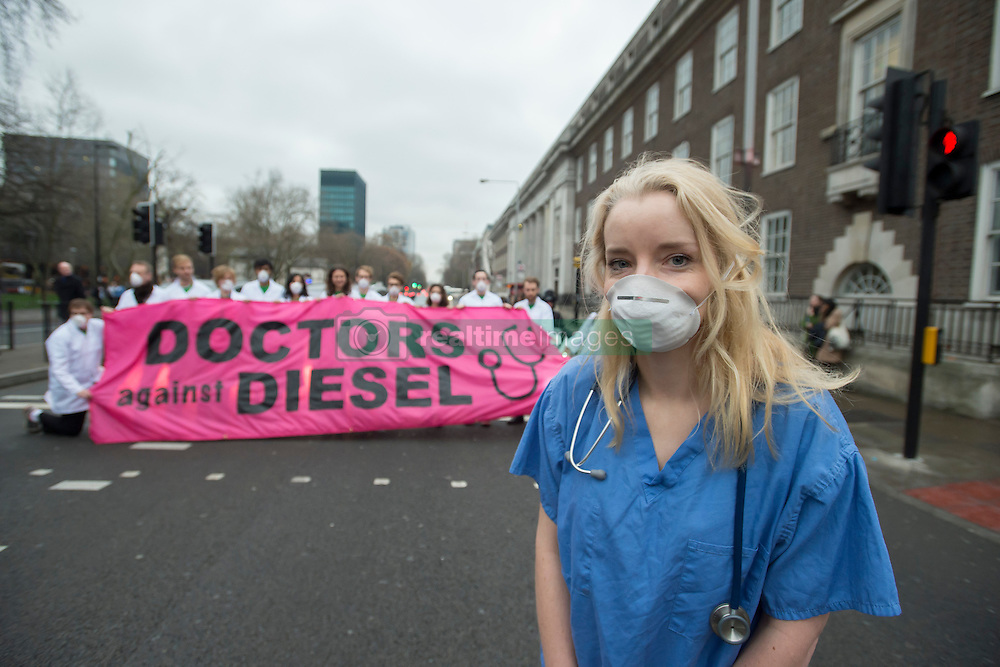 December 10, 2016 - London, London, United Kingdom - Image ¬©Licensed to i-Images Picture Agency. 10/12/2016. London, United Kingdom. Doctors Against Diesel campaign launch. Nurse Alice Munro, with other campaigners from Doctors Against Diesel, gather on Euston Road, London, calling for Sadiq Khan, Mayor of London, to commit to phase out diesel vehicles from London, and for the public to respond to a TFL public consultation in support of the phasing out of diesel in London. Doctors Against Diesel is an emerging group of medical professionals who are drawing attention to the link between the use of diesel fuels, air pollution and a public health emergency. Picture by David Mirzoeff / i-Images (Credit Image: © David Mirzoeff/i-Images via ZUMA Wire)