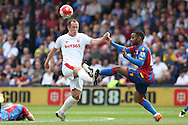 Charlie Adam of Stoke City and Jason Puncheon of Crystal Palace challenge  for the ball. Barclays Premier League match, Crystal Palace v Stoke City at Selhurst Park in London on Saturday 7th May 2016. pic by John Patrick Fletcher, Andrew Orchard sports photography.