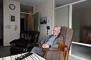 elderly man watching television