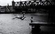 2000 August- Matanzas, Cuba- ' A Leap Towards Freedom' -Cuban teens practice the art of staying young and enjoying life by diving off piers, this one in Matanzas, Cuba August, 2000