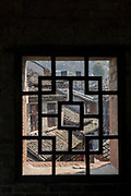 View of old town through a small Chinese style window from the East Gate Tower, Fenghuang, Hunan Province, China