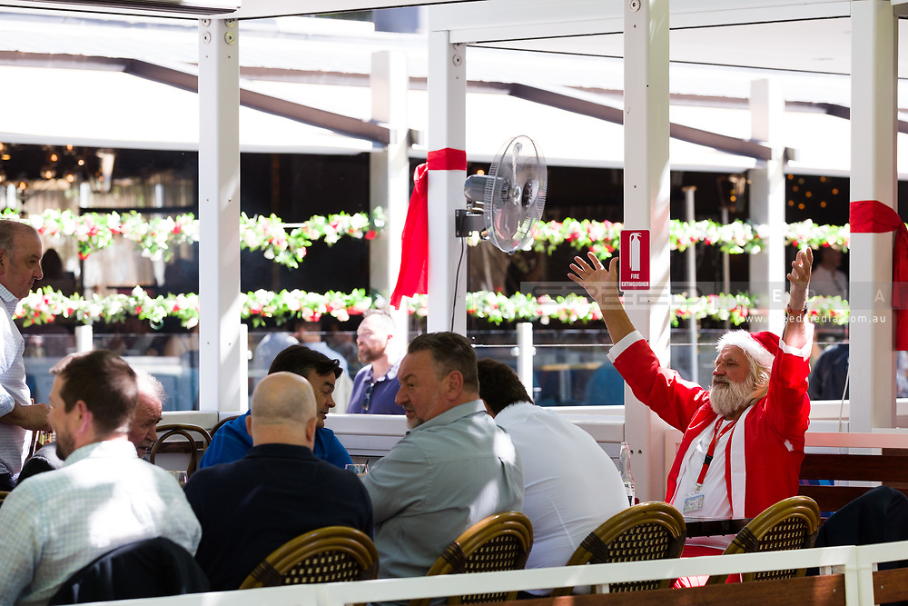 Santa Clause is seen enjoying lunch on the Yarra Banks during the 35th day of zero COVID-19 cases in Victoria, Australia. School and community sport is ramping up and as the weather improves, more people are venturing out and about to enjoy this great city. Pressure is mounting on Premier Daniel Andrews to keep his promise of removing all remaining restrictions. (Photo by Dave Hewison/Speed Media)