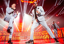 © Licensed to London News Pictures . 05/04/2014 . Manchester , UK . Brian Littrell , A J McLean and Howie Dorough . The Backstreet Boys play at the Phones4U Arena in Manchester this evening (Saturday 5th April 2014) . Photo credit : Joel Goodman/LNP