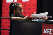 LAS VEGAS, NV - JULY 9:  A young fan gets an autograph from one of the Octagon girls during the UFC Fan Expo at the Las Vegas Convention Center on July 9, 2016 in Las Vegas, Nevada. (Photo by Cooper Neill/Zuffa LLC/Zuffa LLC via Getty Images) *** Local Caption ***