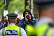 """London, United Kingdom, May 28, 2021: A man is seen shouting slogans """"Free! Free! Palestine"""" - during a protest outside HQ Office of Elbit Systems in central London on Friday, May 28, 2021. Elbit is an Israel-based international defence electronics company engaged in a wide range of weapons programs throughout the world. (Photo by Vudi Xhymshiti)"""