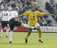 Photo: Aidan Ellis.<br /> Preston North End v Norwich City. Coca Cola Championship. 08/04/2006.<br /> Norwich's Robert Earnshaw beats Preston's Graham Alexander to the ball