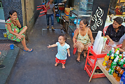 Family - Toddler Passing Cigarette From One Person To Another
