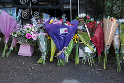 © Licensed to London News Pictures.  03/03/2015, Bristol, UK.  Flowers and tributes are left at the home of Rebecca Watts' family in St George, after body parts were found in Barton Court, Barton Hill during the search for missing teenager Rebecca Watts aged 16 who left home a mile away in Crown Hill in the St George area of Bristol last Thursday. Police have carried out extensive searches across Bristol and today said they had found body parts in Barton Court. Up to 7 people have now been arrested in connection with the case with 2 arrested on suspicion of the murder of Becky Watts, having previously been arrested on suspicion of kidnapping her.  Photo credit : Simon Chapman/LNP