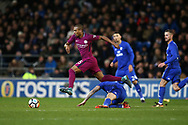 Fernandinho of Manchester city jumps over a challenge from Cardiff city's Joe Ralls. The Emirates FA Cup, 4th round match, Cardiff city v Manchester City at the Cardiff City Stadium in Cardiff, South Wales on Saturday 28th January 2018.<br /> pic by Andrew Orchard, Andrew Orchard sports photography.