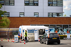 © Licensed to London News Pictures . 18/05/2021. Manchester , UK . A mobile Coronavirus testing station has been built on a car park behind Manchester College in Ardwick after a cluster of cases was identified at the college's Ardwick campus on Friday (14th May 2021). Photo credit : Joel Goodman/LNP