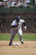 CHICAGO - APRIL 14:  Prince Fielder #28 of the Milwaukee Brewers runs the bases against the Chicago Cubs on April 14, 2010 at Wrigley Field in Chicago, Illinois.  The Cubs defeated the Brewers 7-6.  (Photo by Ron Vesely)