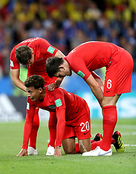 England's Dele Alli crouches on the floor injured as team mates John Stones (left) and Harry Maguire check on him during the FIFA World Cup 2018, round of 16 match at the Spartak Stadium, Moscow.