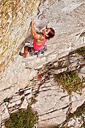"""Jessica Taverna climbs """"Equipment Overhang"""" 11a, Gate Buttress, Little Cottonwood Canyon, Wasatch Range, Utah."""