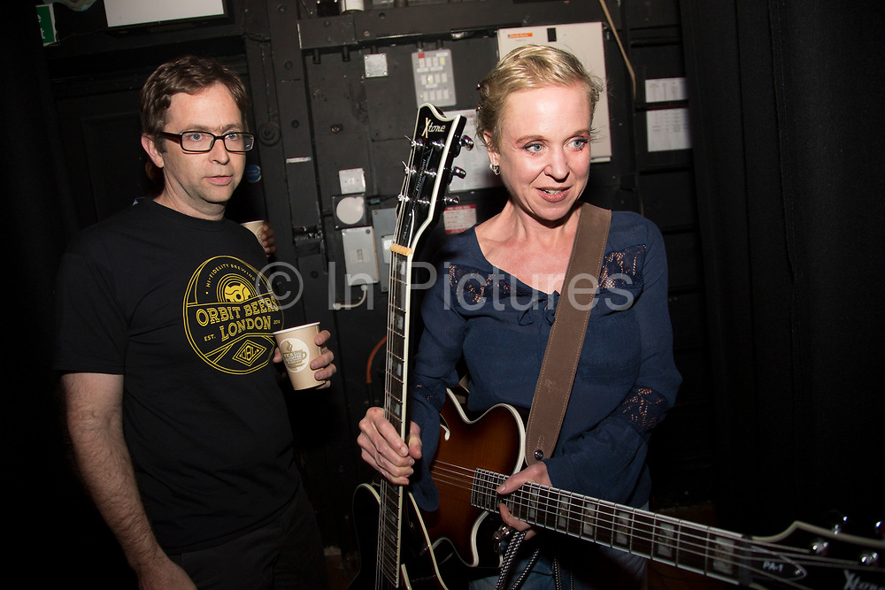 The band just before going onstage. Throwing Muses at the Islington Assembly Hall, London, UK. Throwing Muses are an alternative rock band founded in 1980. The group was originally fronted by two lead singers, Kristin Hersh, and Tanya Donelly. Known for performing music with shifting tempos, creative chord progressions, unorthodox song structures, and surreal lyrics, the group was set apart from other contemporary acts by Hersh's stark, writing style, David Narcizo's unusual drumming techniques almost totally without cymbals and Bernard Georges' driving baselines.