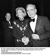 Mr. & Mrs. Rupert Murdoch. Mort Zuckerman ( owner of the Post rival N.Y. Daily News ) on right.  New York magazine celebration. Metropolitan Museum. New York. 1993. Film93275f19<br /> © Copyright Photograph by Dafydd Jones<br /> 66 Stockwell Park Rd. London SW9 0DA<br /> Tel 0171 733 0108