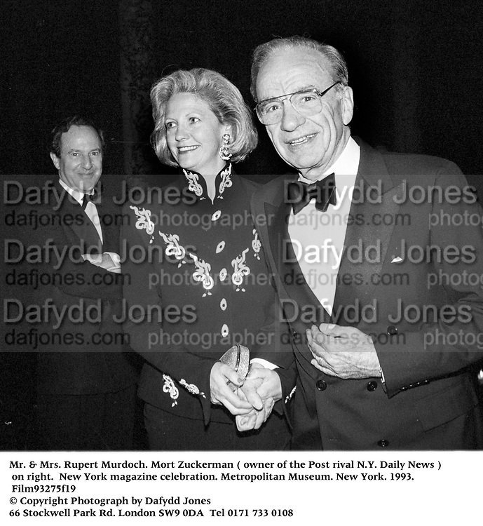 Mr. & Mrs. Rupert Murdoch. Mort Zuckerman ( owner of the Post rival N.Y. Daily News ) on right.  New York magazine celebration. Metropolitan Museum. New York. 1993. Film93275f19<br /> © Copyright Photograph by Dafydd Jones<br /> 66 Stockwell Park Rd. London SW9 0DA<br /> Tel 0171 733 0108