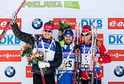 Second placed Emil Hegle Svendsen (NOR), winner Jean Guillaume Beatrix (FRA) and third placed Ole Einar Bjoerndalen (NOR) at medal ceremony after the  Men 15 km Mass Start at day 4 of IBU Biathlon World Cup 2015/16 Pokljuka, on December 20, 2015 in Rudno polje, Pokljuka, Slovenia. Photo by Vid Ponikvar / Sportida