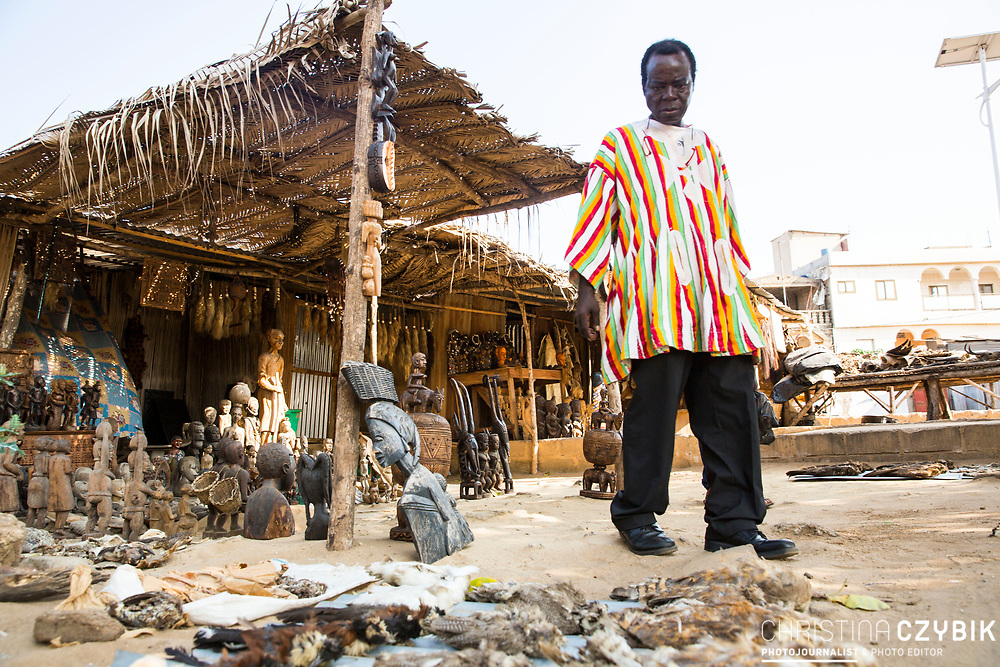 King Cephas Bansah visits the traditional Voodoo market in Lome, Togo on September 4th, 2016.<br /> <br /> People come to this market to buy supplies they can bring to their Voodoo priests to perform  Voodoo.<br /> <br /> ***Togbe Ngoryifia Cephas Kosi Bansah of Gbi Traditional Area Hohoe Ghana and Traditional, Spiritual and Honorable King of the Ewes***