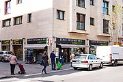 Social distancing - shoppers queue outside supermarket. 21 March 2020 - one week into lockdown. Empty streets in Sant Cugat del Valles, a normally bustling city of some 90,000 people outside Barcelona, a week after Spain exerted a state of Emergency to deal with the spread Coronavirus. Spain is one of the worst affected countries. Schools and retail businesses are closed, except for supermarkets and pharmacies.