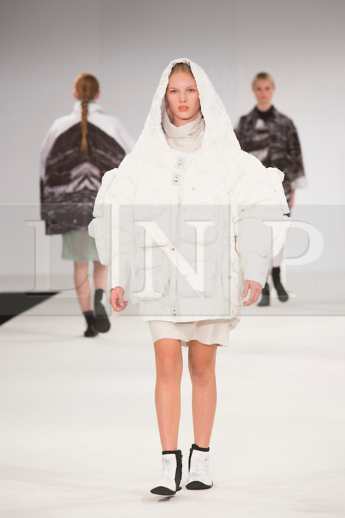 © Licensed to London News Pictures. 30/05/2015. London, UK. A model walks the runway during the UCA Rochester fashion show at Graduate Fashion Week 2015 wearing the collection of graduate student Aman Jaswal. Graduate Fashion Week takes place from 30 May to 2 June 2015 at the Old Truman Brewery, Brick Lane. Photo credit : Bettina Strenske/LNP