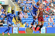 QPR's Sebastian Polter (r) and Frederic Gounongbe (c) challenge for a header. EFL Skybet championship match, Cardiff city v Queens Park Rangers at the Cardiff city stadium in Cardiff, South Wales on Sunday 14th August 2016.<br /> pic by Carl Robertson, Andrew Orchard sports photography.