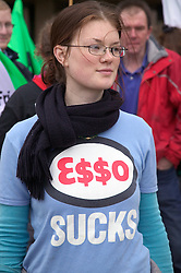 Friends of the Earth supporter wearing protest tshirt,