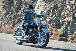 A modern bike rides up the steep mountain pass just out of Palm Desert on the Palms to Pines Scenic Byway chasing the old bikes on the last day of the Motorcycle Cannonball Race of the Century. Stage-15 ride from Palm Desert, CA to Carlsbad, CA. USA. Sunday September 25, 2016. Photography ©2016 Michael Lichter.