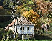 Romania, Transylvania, Biertan, village street with well kept painted houses