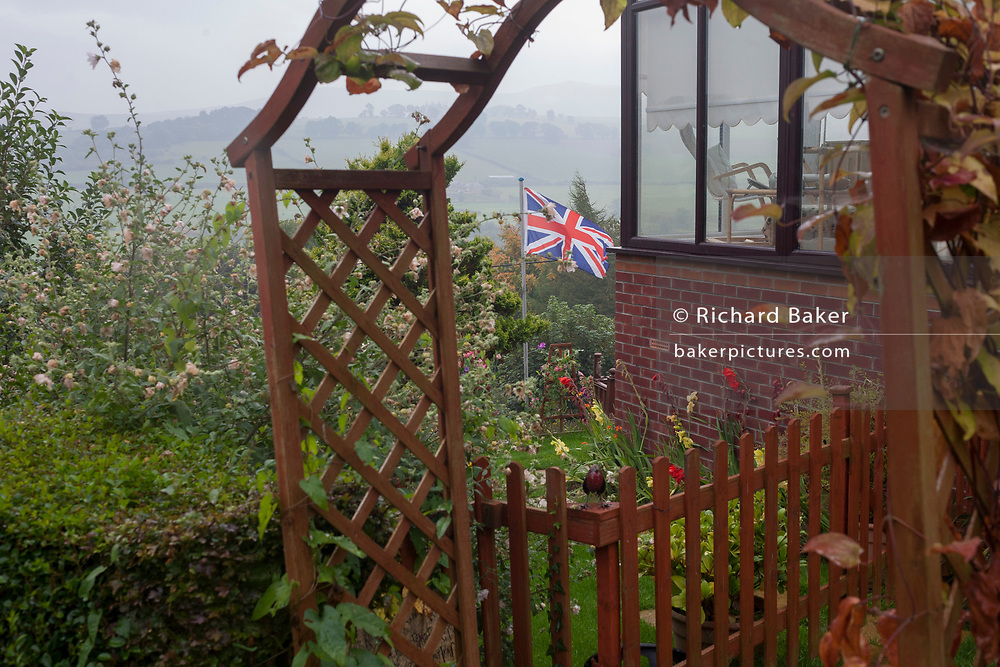 A Union Jack flies in the rear garden of a small house that overlooks the Coquet Valley hills, on 25th September 2017, in Rothbury, Northumberland, England.