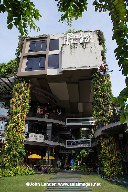 Rain Hill was designed as a peaceful sanctuary, using the buildings' green facades to absorb heat and noise.  Its concept is an ecosystem, the original existing trees were preserved, giving natural shade and a cooler atmosphere.  The building also uses a high tech water based air conditioninig system to support minimalizing impact on the environment.