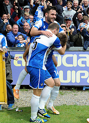 Bristol Rovers' Jake Gosling and Bristol Rovers' Mark McCrystal celebrate with Bristol Rovers' Chris Lines after he got the first goal - Photo mandatory by-line: Neil Brookman/JMP - Mobile: 07966 386802 - 03/05/2015 - SPORT - Football - Bristol - Memorial Stadium - Bristol Rovers v Forest Green Rovers - Vanarama Football Conference