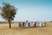 Muslims pray to the east during a  funeral in the desert, Burkina Faso, formerly Upper Volta, Africa