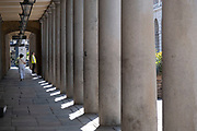 Streets in Covent Garden remain incredibly quiet apart from a few people under Coronavirus lockdown on 25th June 2020 in London, England, United Kingdom. As the July deadline approaces and government will relax its lockdown rules further, the West End remains quiet, while some non-essential shops are allowed to open with individual shops setting up social distancing systems.