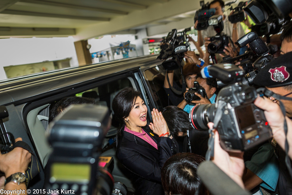 """09 JANUARY 2105 - BANGKOK, THAILAND: YINGLUCK SHINAWATRA, former Prime Minister of Thailand, says goodbye to supporters and gets in a waiting car after presenting her defense during her impeachment at the National Legislative Assembly. Thailand's military-appointed National Legislative Assembly began impeachment hearings Friday against former Prime Minister Yingluck Shinawatra. If she is convicted, she could be forced to stay out of politics for five years. During her defense, Yingluck questioned the necessity of her impeachment, saying, """"I was removed from office, the equivalent of being impeached, three times already, I have no position left to be impeached from."""" A decision on her impeachment is expected by the end of January.    PHOTO BY JACK KURTZ"""