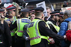 © Licensed to London News Pictures . 27/09/2018 . London , UK . Supporters of and those against former EDL leader Tommy Robinson (real name Stephen Yaxley-Lennon ) outside the Old Bailey , as Robinson faces a retrial for Contempt of Court following his actions outside Leeds Crown Court in May 2018 . Robinson was already serving a suspended sentence for the same offence when convicted in May and served time in jail as a consequence , but the newer conviction was quashed by the Court of Appeal and a retrial ordered . Photo credit: Joel Goodman/LNP