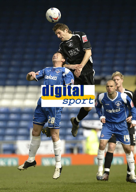 Photo: Aidan Ellis.<br /> Oldham Athletic v Swansea City. Coca Cola League 1. 22/04/2006.<br /> Swansea's Sam Ricketts gets up well to win the header against Oldham's David eyres