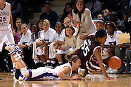 Texas A&M's Danielle Gant (55) and Kansas State's Shalee Lehning (L) dive after a loose ball in the first half at Bramlage Coliseum in Manhattan, Kansas, January 6, 2007.  K-State upset 17th ranked Texas A&M 48-45.