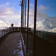 Tourists view the snow capped mountains and Lake Wakatipu viewed from the Skyline Gondola,  Queenstown, New Zealand. Photo Tim Clayton