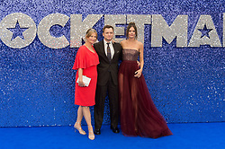 May 20, 2019 - London, England, United Kingdom - (L-R) Christine Egerton, Taron Egerton and Emily Thomas arrive for the UK film premiere of 'Rocketman' at Odeon Luxe, Leicester Square on 20 May, 2019 in London, England. (Credit Image: © Wiktor Szymanowicz/NurPhoto via ZUMA Press)