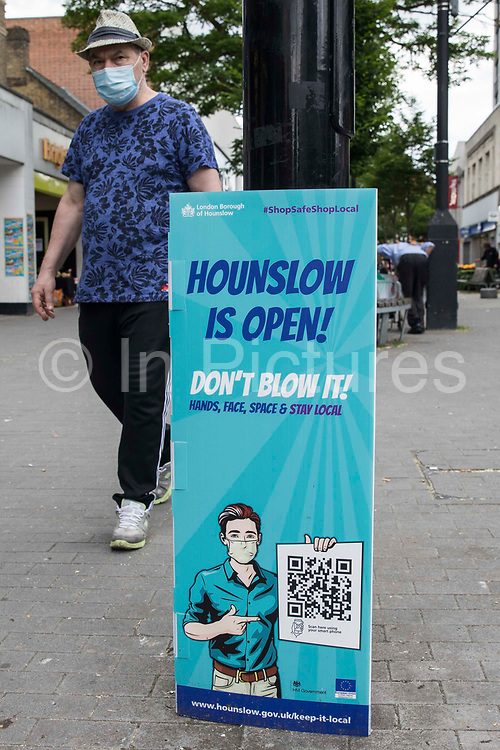 Local residents pass a London Borough of Hounslow Covid-19 public information notice amid rising concern regarding the spread of the Delta variant on 11th June 2021 in Hounslow, United Kingdom. Hounslow has been identified as a hotspot for the Delta variant first identified in India and both surge testing and increased vaccination have been introduced as counter-measures.