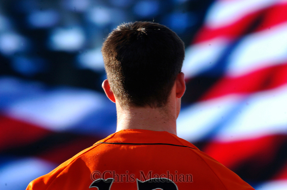 06/22/2006 Oregon State's Erik Ammon during the national anthem.  The video scoreboard is in front of him.  Before Game thirteen of the College Word Series..(photo by Chris Machian/Prairie Pixel Group)