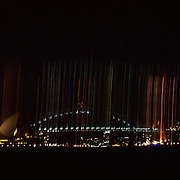 A Panoramic view of Sydney at night showing the Sydney Opera House and Harbour Bridge in Sydney, Australia on December 09, 2008 Photo Tim Clayton