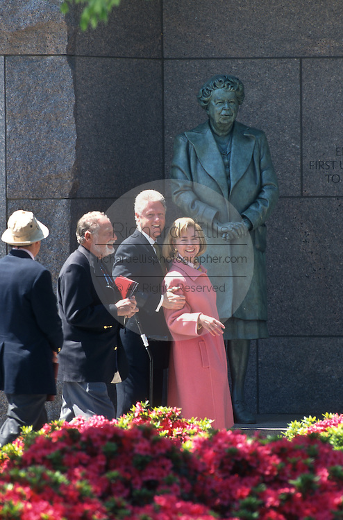 President Bill Clinton and First Lady Hillary walk past a statue of Eleanor during a walk through of the FDR Memorial May 2, 1997 in Washington, DC. Accompanying the Clintons are the designer of the memorial Lawrence Halprin and sculptor Neil Estrin.