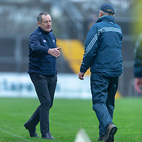 Cork's Manager John Meagher and Clare's Co-Manager Donal Moloney shake hands at the final whistle