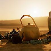 Steaming kettle and teapots at a Tuareg camp, Sahara, Libya
