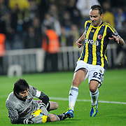 Fenerbahce's Semih Senturk (R) and Trabzonspor's goalkeeper Tolga Zengin (L) during their Turkish superleague soccer derby match Fenerbahce between Trabzonspor at the Sukru Saracaoglu stadium in Istanbul Turkey on Sunday 18 December 2011. Photo by TURKPIX