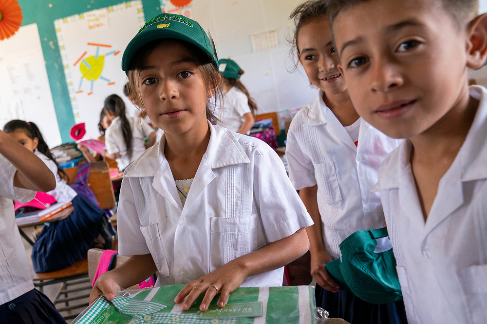 CAMO staff distributes clothing and backpacks to children in local schools outside of Santa Rosa de Copan, Copan on Monday, February 17, 2020.     Photo by Ken Cedeno