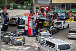 Licensed to London News Pictures. 25/09/2021. London, UK. Large queues form on the second day of the fuel crisis at a petrol station on the A3 near Kingston, south-west London today as desperate motorists stop to fill up. Yesterday, petrol stations across London and the South East were on critical levels with many running out of fuel as oil giants struggle to maintain deliveries due to the lack of HGV drivers. Photo credit: Alex Lentati/LNP