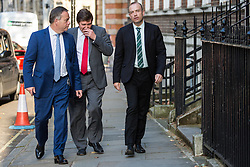 London, UK. 23 July, 2019. Guests including Chris Heaton-Harris (r), Conservative MP for Daventry, arrive to attend a celebration in Westminster of Boris Johnson's election as Conservative Party leader and replacement of Theresa May as Prime Minister organised by the pro-Brexit European Research Group (ERG).