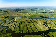 Nederland, Noord-Holland, Gemeente Wormerland, 13-06-2017; Wijdewormer ook (De) Wormer. Onderdeel van polder en droogmakerij Polder Wormer, Jisp en Nek. De verkaveling in het gebied is het resultaat van veenontginning<br /> Polder in province North-Holland (above Amsterdam) with villages. The division in plots in the area is the result of peat extraction.<br /> <br /> luchtfoto (toeslag op standard tarieven);<br /> aerial photo (additional fee required);<br /> copyright foto/photo Siebe Swart
